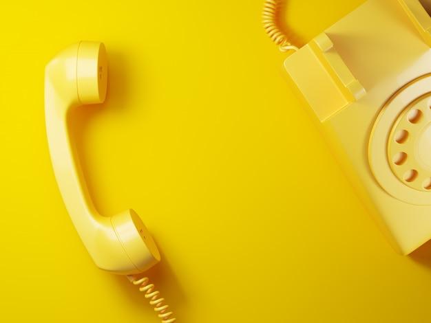 Weinlese gelber telefonempfänger auf gelbem hintergrund 3d Premium Fotos