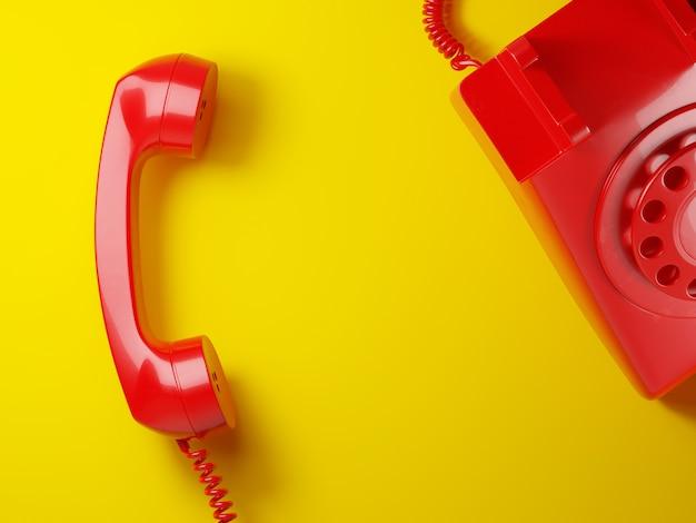 Weinlese roter telefonempfänger auf gelbem hintergrund 3d Premium Fotos