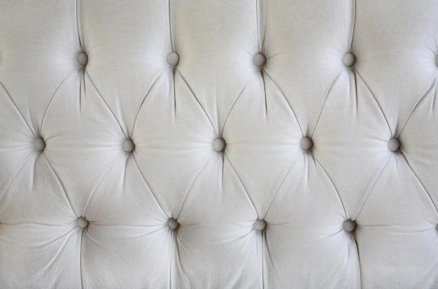 Weinleseartgewebe mit knopfbeschaffenheit des sofas Premium Fotos