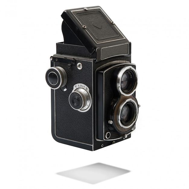 Weinlesekamera auf weißem hintergrund Premium Fotos