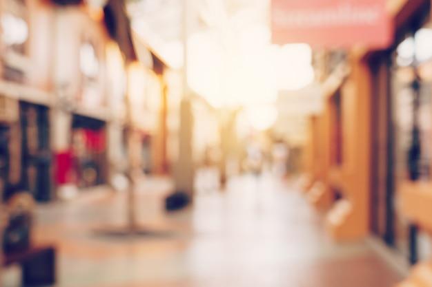 Weinleseton verwischte defocused tag von mengenleuten in gehendem straßenfestival und in einkaufszentrum. Premium Fotos