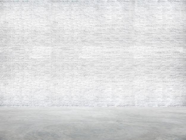 Weiße backsteinmauer und zement-boden Kostenlose Fotos
