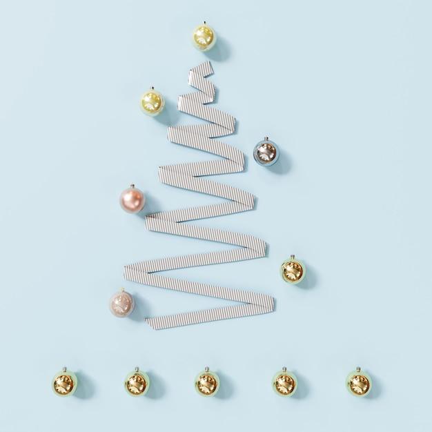 Weiße band-weihnachtstagesdekorationsgegenstände formen durch weihnachtsbaum auf blau. minimale idee. 3d-rendering. Premium Fotos