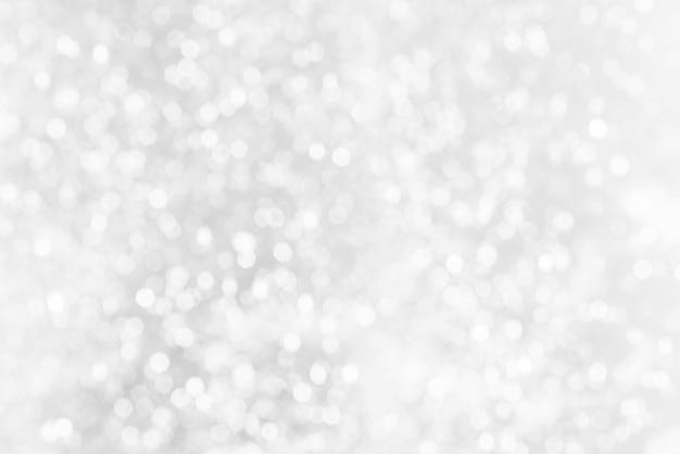 Weiße bokeh abstrakte beschaffenheit. verschwommenes helles licht in der nacht. Premium Fotos
