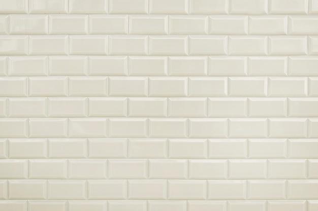 Weiße fliesenbacksteinmauer-hintergrundbeschaffenheit Premium Fotos