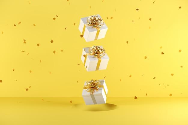 Weiße geschenkbox mit der goldenen bandfarbe, die auf gelben hintergrund schwimmt Premium Fotos