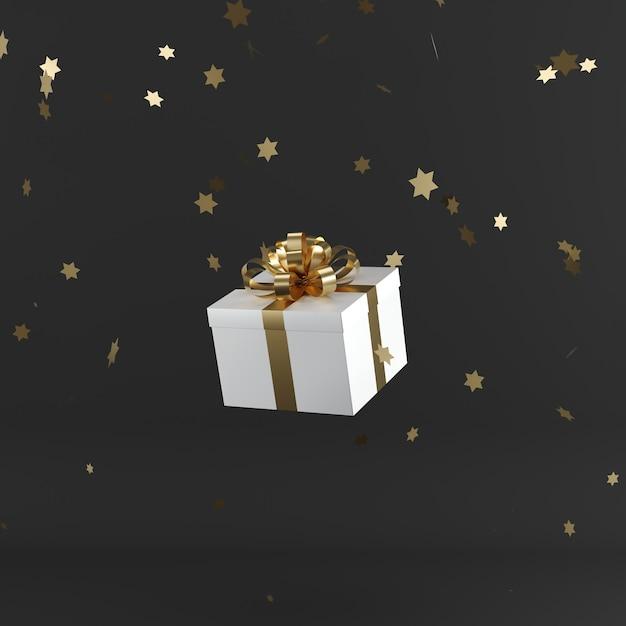 Weiße geschenkbox mit goldenem farbband auf schwarzem farbhintergrund Premium Fotos