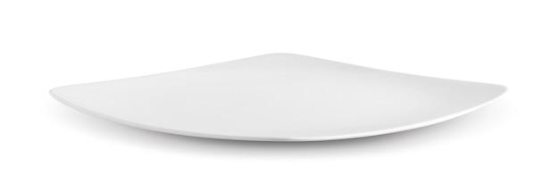 Weiße platte auf weißer wand Premium Fotos