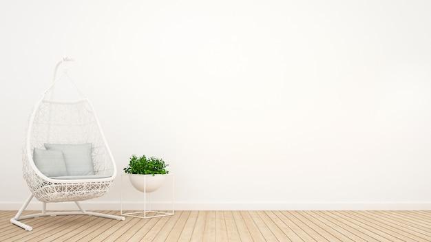 Weiße rattanwiege und -anlage entspannen herein sich raum - wiedergabe 3d Premium Fotos