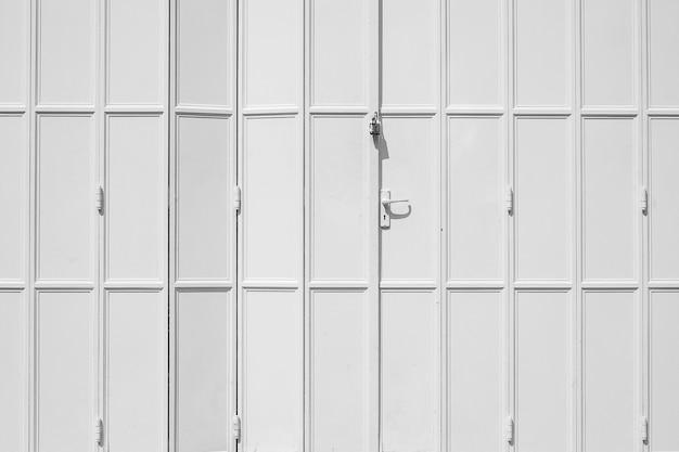 Weiße und graue farbe der tür, abstrakter musterhintergrund Premium Fotos