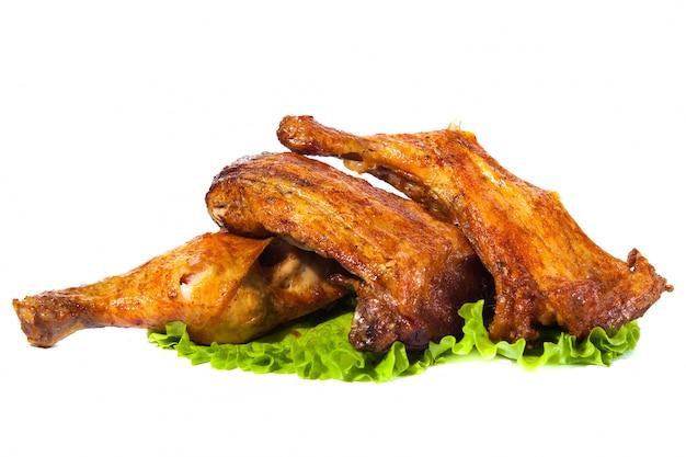 Weißes hintergrundisolat des hühnerschenkelgrills Premium Fotos
