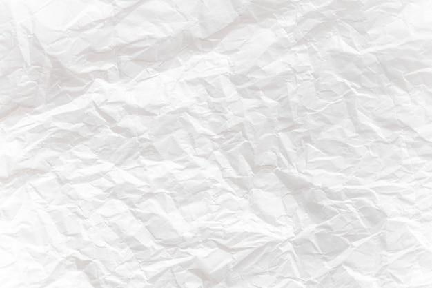 Weißes zerknittertes papier schließen den texturhintergrund Premium Fotos