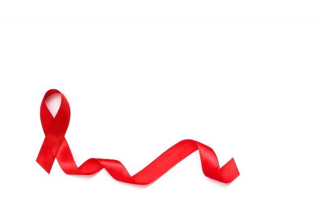 Welt-aids-tag. rotes band auf weißem hintergrund Premium Fotos
