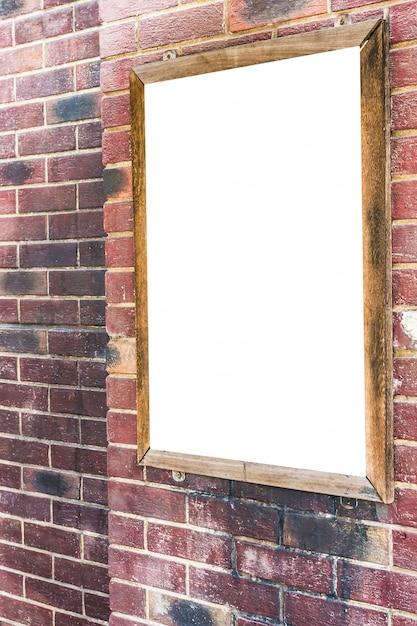 Werbung des leeren zeichens auf backsteinmauer Kostenlose Fotos