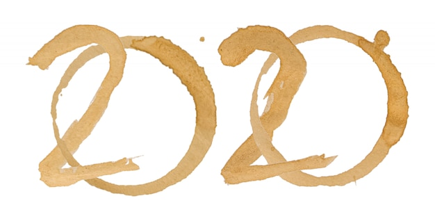 Wort-alphabet 2020 wird von den kaffeeflecken gemacht, die auf weiß lokalisiert werden Premium Fotos
