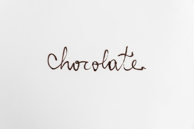 Wortschokolade geschrieben durch geschmolzene schokolade Kostenlose Fotos