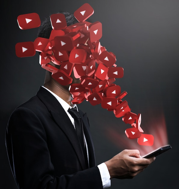 Youtube-symbole tauchen im gesicht eines mannes auf Premium Fotos