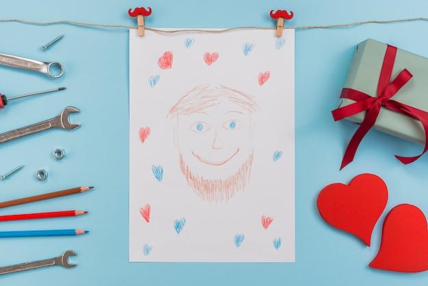 Zeichnung des mannes mit werkzeugen und geschenk Kostenlose Fotos