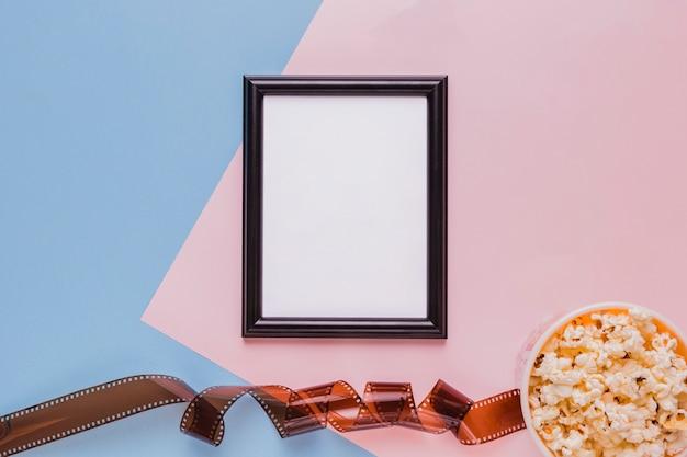 Zelluloid mit popcornbox und rahmen Kostenlose Fotos