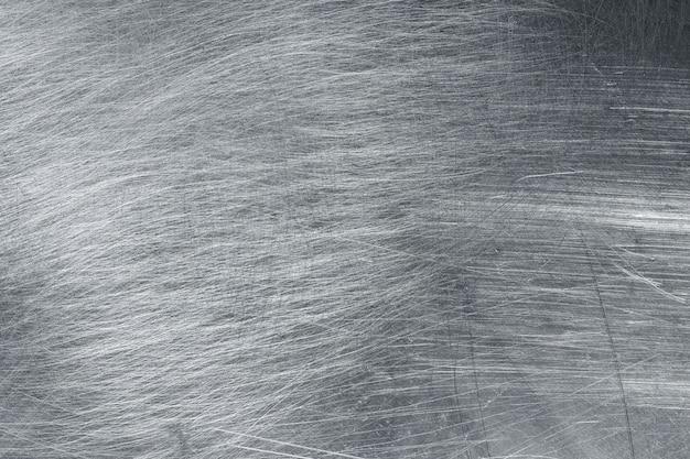 Zerkleinertes eisen, textur aus abgenutztem metall. edelstahlschablone für design Premium Fotos