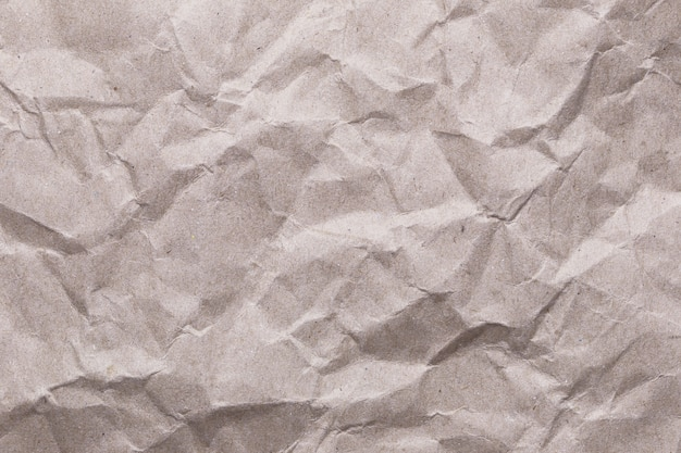 Zerknitterter weinlesepapier-beschaffenheitshintergrund für den designoberflächenhintergrund in ihrer arbeit. Premium Fotos