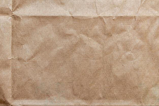 Zerknittertes bastelpapier, kartonbeschaffenheitshintergrund Premium Fotos