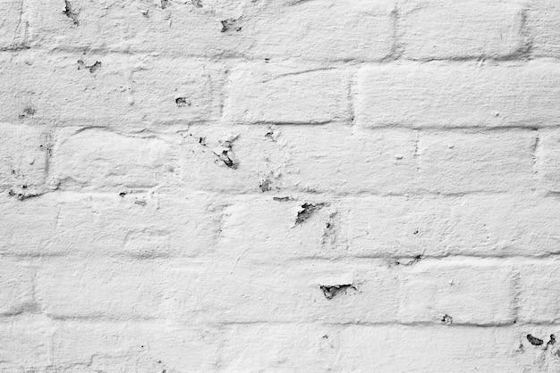Ziegelsteinbeschaffenheit mit kratzern und sprüngen Premium Fotos