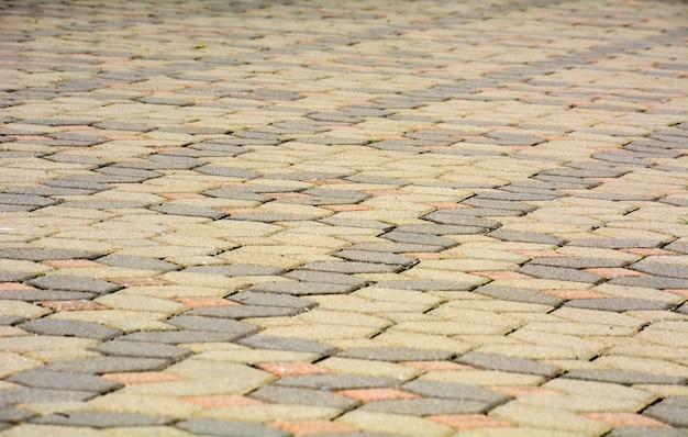 Ziegelsteinpflastersteine auf einer bürgersteigshintergrundbeschaffenheit Premium Fotos