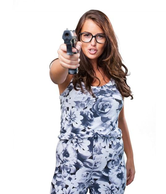 Ziemlich mafia frau mit einer pistole Kostenlose Fotos