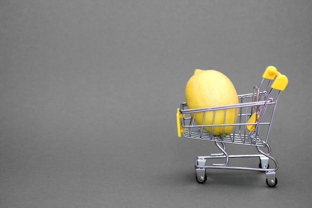 Zitrone im einkaufswagen Premium Fotos