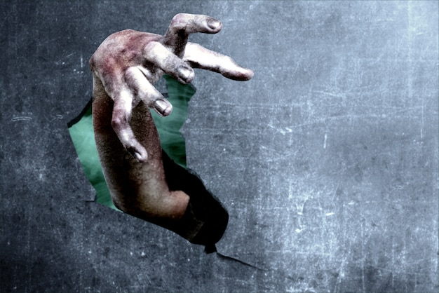 Zombies hände aus zerbrochenen mauern Premium Fotos