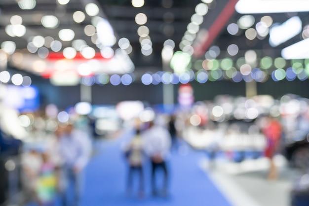 Zusammenfassung unscharfer defocused handelsereignis-ausstellungshintergrund Premium Fotos