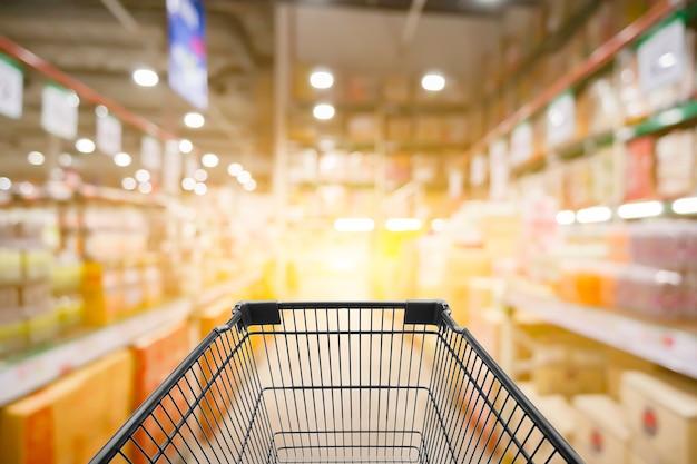 Zusammenfassung unscharfes foto des speichers mit laufkatze im kaufhaus bokeh hintergrund Premium Fotos