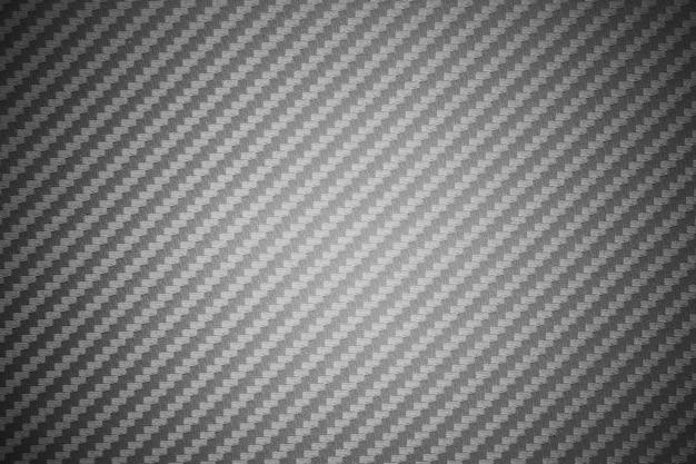 Zusammengesetzter rohstoffhintergrund der grauen kohlenstofffaser Premium Fotos