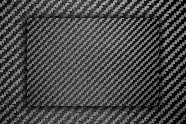 Zusammengesetzter rohstoffhintergrund der roten kohlenstofffaser Premium Fotos