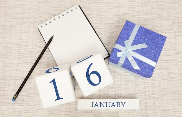 1月16日のトレンディな青色のテキストと数字のカレンダー、および箱入りギフト Premium写真