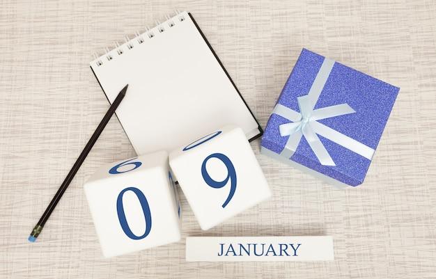 トレンディな青色のテキストと1月9日の数字とボックスのギフトのカレンダー Premium写真
