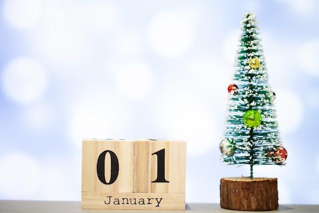 1 january and christmas decoration on blue background Premium Photo