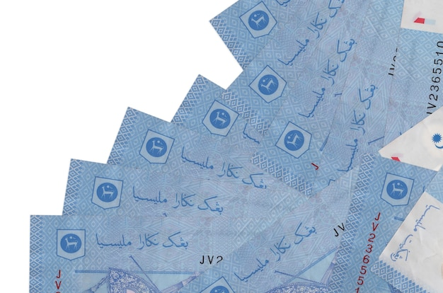 1 malaysian ringgit bills lies in different order isolated on white. local banking or money making concept. Premium Photo