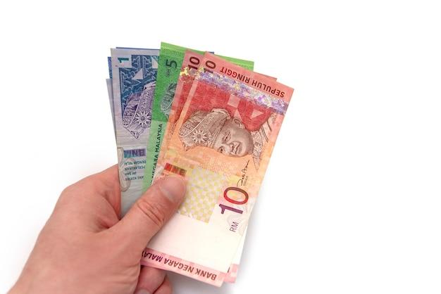10 malaysian ringgit banknote on hand Premium Photo