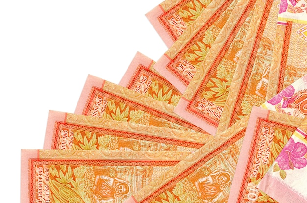 100 sri lankan rupees bills lies in different order isolated on white. local banking or money making concept. Premium Photo