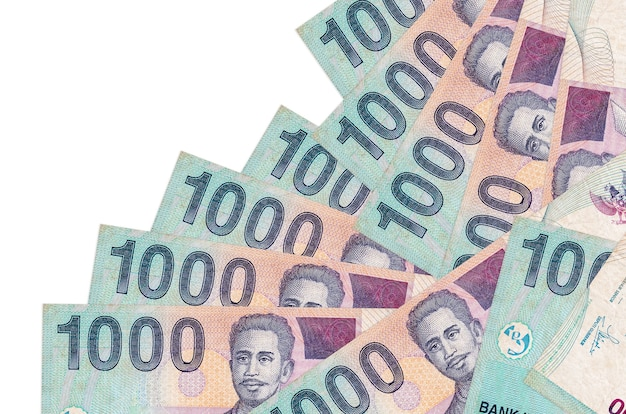 1000 indonesian rupiah bills lies in different order isolated on white. local banking or money making concept. Premium Photo