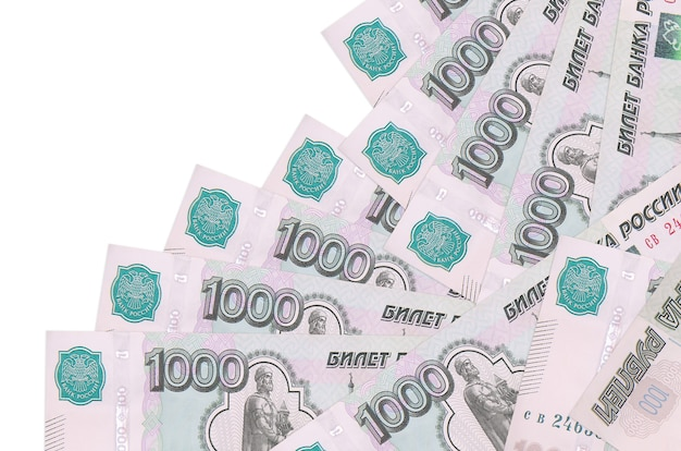 1000 russian rubles bills lies in different order isolated on white. local banking or money making concept. Premium Photo