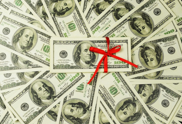 たくさんのお金の背景銀行券100ドル Premium写真