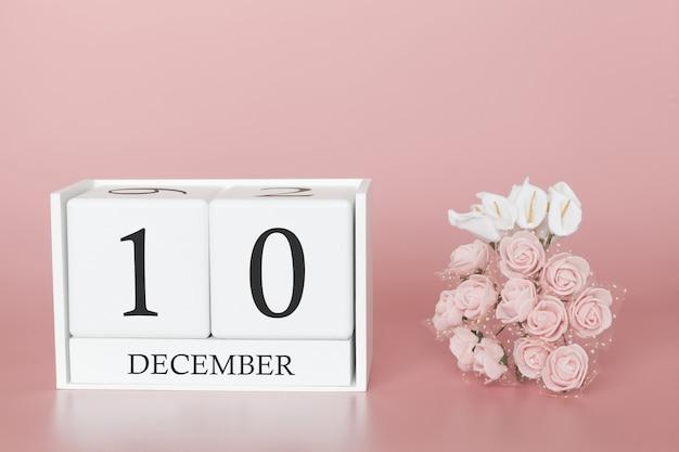 12月10日月の10日モダンなピンク色の背景、ビジネスの概念と重要なイベントのカレンダーキューブ。 Premium写真