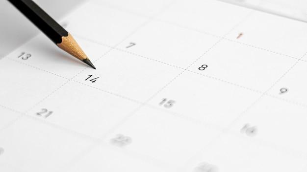 カレンダーの2月14日。バレンタインデーのコンセプト。 Premium写真