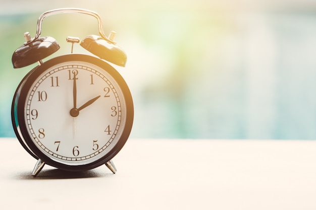 2 o'clock retro clock at the swimming pool outdoor relax time holiday time concept Premium Photo