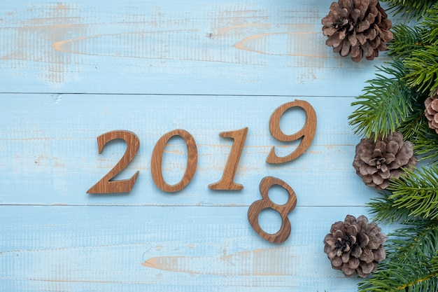 2018 - 2019 number with christmas decorations on wooden background Premium Photo