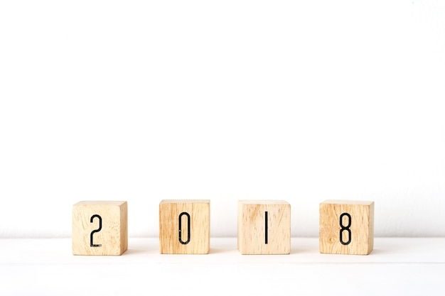 2018 new year greeting card template 2018 on wooden cubes on white table and white