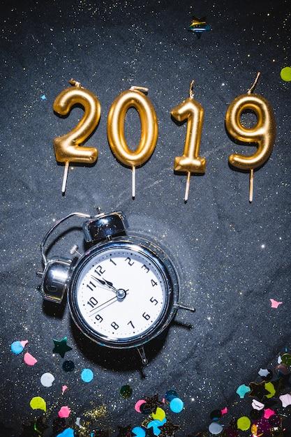 2019 candles near vintage clock Free Photo